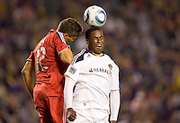 LA Galaxy forward Edson Buddle (14) beats Toronto FC defender Adrian Cann (12) to the head ball. The LA Galaxy and Toronto FC played to a 0-0 draw at Home Depot Center stadium in Carson, California on Saturday May 15, 2010.  .