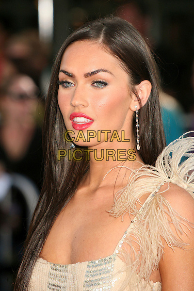 "MEGAN FOX.""Transformers"" Los Angeles Premiere at Mann's Village Theatre, Westwood, California, USA..June 27th, 2007.headshot portrait pink lipstick silver beige sequins sequined feather shoulder .CAP/ADM/BPC.©Brent Perniac/AdMedia/Capital Pictures"