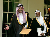 Prince Saud al-Faisal, Foreign Minister of Saudi Arabia, left, and Prince Turki al-Faisal, Ambassador of Saudi Arabia to the United States, right, departs the White House after meeting United States President George W. Bush in the Oval Office of the White House in Washington, D.C. on July 23, 2006.  They were meeting before United States Secretary of State Condoleezza Rice departs for the Middle East to try to broker a cease-fire between Israel and Hezbollah.  Prince Saud bin Faisal bin Abdulaziz Al Saud passed away of undisclosed causes on Thursday, July 9, 2015.<br /> Credit: Ron Sachs / CNP