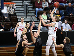 SIOUX FALLS, SD - MARCH 10:  Evan Maxwell #50 from Indiana Wesleyan shoots over Trey Brown #32 from Morningside during their quarterfinal game at the 2018 NAIA DII Men's Basketball Championship at the Sanford Pentagon in Sioux Falls. (Photo by Dave Eggen/Inertia)