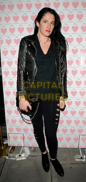 AMY MOLYNEAUX.At the PRPS Heart Start Launch Party, Start Boutique, London, England, UK, .3rd September 2009..full length black leather jacket top leggings ripped cut out ankle boots bag clutch chain strap .CAP/CAN.©Can Nguyen/Capital Pictures