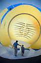 07/08/15<br /> <br /> Nick Langley shows six-year-old Ben Wilkinson the inside of his Minion balloon which is valued at &pound;100,000. <br /> <br /> Hundreds of hot air balloons take to the skies on the second day of three <br /> day Bristol International Balloon Fiesta.<br /> <br /> All Rights Reserved - F Stop Press.  www.fstoppress.com. Tel: +44 (0)1335 418629 +44(0)7765 242650