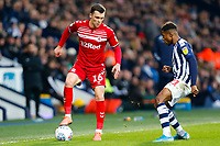 29th December 2019; The Hawthorns, West Bromwich, West Midlands, England; English Championship Football, West Bromwich Albion versus Middlesbrough; Jonny Howson of Middlesbrough holds the ball up under pressure from Kyle Edwards of West Bromwich Albion - Strictly Editorial Use Only. No use with unauthorized audio, video, data, fixture lists, club/league logos or 'live' services. Online in-match use limited to 120 images, no video emulation. No use in betting, games or single club/league/player publications