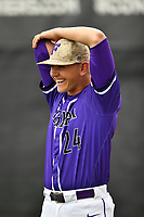 Starting pitcher Will Gaddis (24) of the Furman Paladins laughs with teammates as he stretches before a game against the Wofford Terriers on Friday, March 24, 2017, at Russell C. King Field in Spartanburg, South Carolina. Wofford won, 9-8. (Tom Priddy/Four Seam Images)