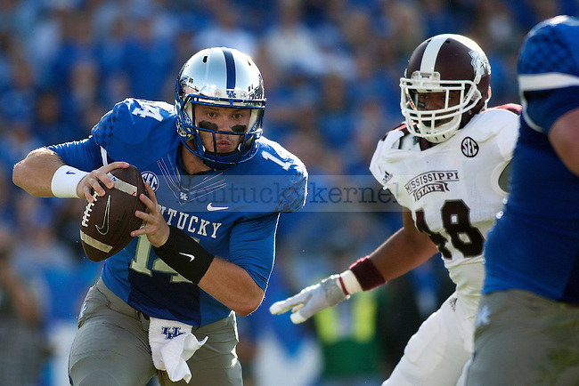 Quarterback Patrick Towles (14) of the Kentucky Wildcats runs during the first half of the game against the Mississippi State Bulldogs at Commonwealth Stadium on Saturday, October 25, 2014 in Lexington, Ky. Mississippi State defeated Kentucky 45-31.Photo by Michael Reaves | Staff