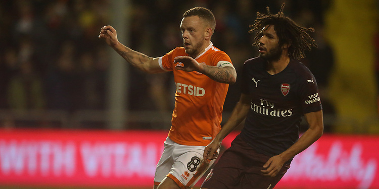Blackpool's Jay Spearing and Arsenal's Mohamed Elneny<br /> <br /> Photographer Stephen White/CameraSport<br /> <br /> Emirates FA Cup Third Round - Blackpool v Arsenal - Saturday 5th January 2019 - Bloomfield Road - Blackpool<br />  <br /> World Copyright &copy; 2019 CameraSport. All rights reserved. 43 Linden Ave. Countesthorpe. Leicester. England. LE8 5PG - Tel: +44 (0) 116 277 4147 - admin@camerasport.com - www.camerasport.com