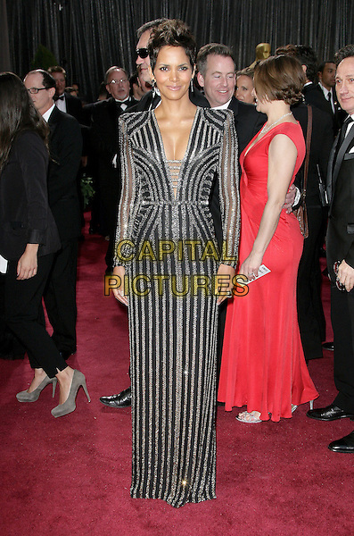 Halle Berry.85th Annual Academy Awards held at the Dolby Theatre at Hollywood & Highland Center, Hollywood, California, USA..February 24th, 2013.oscars full length black gold silver striped stripes dress sequins sequined cleavage .CAP/ADM.©AdMedia/Capital Pictures.