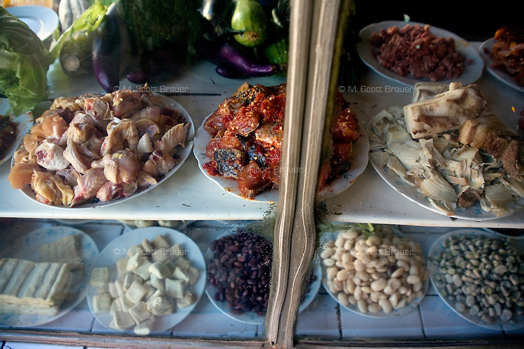 Chicken, fish, tofu, and beans are on display in a restaurant in Kunming, Yunnan Province, China.  The ingredients can be ordered for meals in the restaurant.