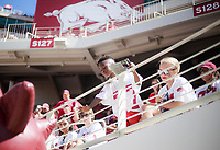 NWA Democrat-Gazette/CHARLIE KAIJO A young fan greets the Arkansas Razorbacks mascot during a football game, Saturday, September 1, 2018 at Razorback Stadium in Fayetteville.