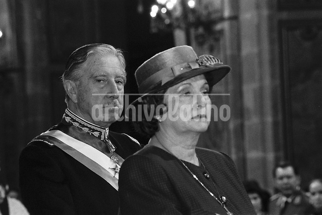 Augusto Pinochet y su esposa Lucia Hiriart asisten al Tedeum de fiestas patrias en la Catedral metropolitana.<br /> Santiago Chile 18 Septiembre1988<br /> <br /> Forty years ago, on September 11, 1973, a military coup led by General Augusto Pinochet toppled the democratic socialist government of Chile. President Salvador Allende was killed during the  attack to seize  La Moneda presidential palace.  In the aftermath of the coup, a quarter of a million people were detained for their political beliefs, 3000 were killed or disappeared and many thousands were tortured.<br /> Some years later in 1981, while Pinochet ruled Chile with iron fist, a young photographer called Juan Carlos Caceres started to freelance in the streets of Santiago and the poblaciones or poor outskirts, showing the growing resistance against the dictatorship. For the next 10 years Caceres photographed every single protest and social movement fighting for the restoration of democracy. He knew that his camera was his only weapon, he knew that his fate was to register the daily violence and leave his images for the History.<br /> In this days Caceres is working to rescue and organize his collection of images in the project Imagenes de la Resistencia   . With support of some Chilean official institutions, thousands of negatives are digitalized and organized to set up the more complete visual heritage of this  violent period of Chile&acute;s history.