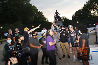 WASHINGTON, D.C. - JUNE 25: A protestor speaks as The National Park Service, in response to threats to topple Emancipation Memorial, fence it off to the public and provide security to deter any damage. The statue depicts Abraham Lincoln standing over a kneeling black slave. June 25, 2020 in Washington, D.C. <br /> CAP/MPI34<br /> ©MPI34/Capital Pictures