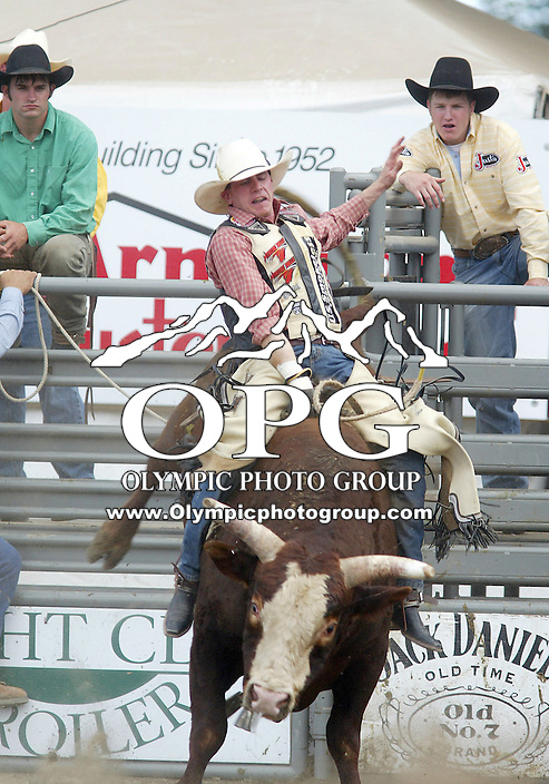 28 August 2005: Greg Fuller holds on during the Extreme Bulls competition Sunday at the Kitsap County Fair Grounds, Fuller scored a 81 in the first round of competition in Bremerton, WA.