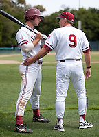 STANFORD, CA - May 22, 2011: Head coach Mark Marquess talks with Jake Stewart of Stanford baseball on the on deck circle during Stanford's game against Arizona at Sunken Diamond. Stanford won 2-1.