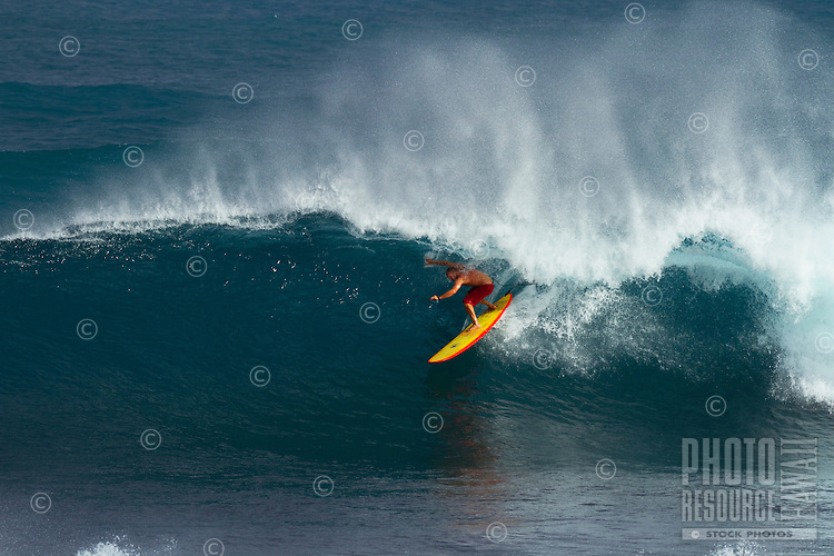 Surfer enjoys waves and kona winds at Ho'okipa Beach Park, Maui.
