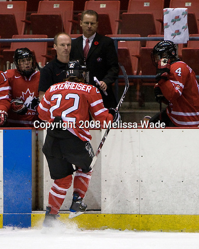Hayley Wickenheiser (Canada - 22) made it to the bench on her own after being injured during the first period.  She did not return to the game. Team USA defeated Team Canada 4-3 (so) to win the 2008 Four Nations Cup on Sunday, November 9, 2008, in the 1980 Rink in Lake Placid, New York.