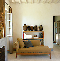 A linen-covered signature Truglio chaise-longue against one wall of the living room