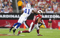 Sept. 27, 2009; Glendale, AZ, USA; Indianapolis Colts defensive back (41) Antoine Bethea grabs the face mask of Arizona Cardinals wide receiver (11) Larry Fitzgerald in the first quarter at University of Phoenix Stadium. Mandatory Credit: Mark J. Rebilas-