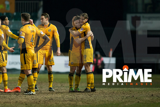 Newport players Mark O'Brien (centre left) and Sid Nelson (centre right) County celebrate their side's point at full time of the goalless Sky Bet League 2 match between Newport County and Doncaster Rovers at Rodney Parade, Newport, Wales on 10 February 2017. Photo by Mark  Hawkins / PRiME Media Images.