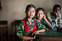 Fulmaya and her twin sister on the way to their village after shopping in Shyaphru. Nepal, 03 May 2013.