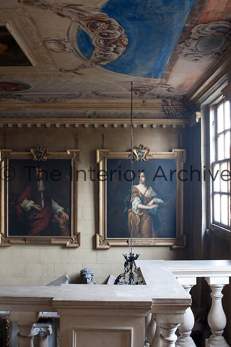 A pair of Restoration portraits hangs above the entrance hall