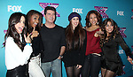 LOS ANGELES, CA - DECEMBER 17: Simon Cowell and Fifth Harmony attend  'The X Factor' season finale press conference at CBS Studios on December 17, 2012 in Los Angeles, California.