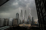 Lightning bolts are seen from our hotel room with the Petronas Towers in the foreground on Wednesday April 24th 2013 in Kuala Lumpur, Malaysia. (Photo by Brian Garfinkel)