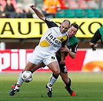 Nederland, Nijmegen, 2 december 2012.Eredivisie .Seizoen 2012-2013.N.E.C.-NAC Breda.Anthony Lurling (l.) van NAC Breda en Rens van Eijden (r.) van N.E.C.
