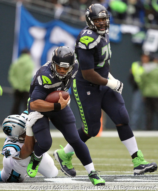 Seattle Seahawks  Russell Wilson is sacked by Carolina Panthers defensive tackle Star Lofulelei (98) at CenturyLink Field in Seattle on October 18, 2015. The Panthers came from behind with 32 seconds remaining in the 4th Quarter to beat the Seahawks 27-23.  ©2015 Jim Bryant Photography. All Rights Reserved.
