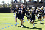 DURHAM, NC - APRIL 08: Notre Dame's William Young (42) plays the bagpipes while leading Bobby Gray (44) and Anthony Marini (4) and the rest of the team onto the field. The Duke University Blue Devils hosted the University of Notre Dame Fighting Irish on April 8, 2017, at Koskinen Stadium in Durham, NC in a Division I College Men's Lacrosse match. Duke won the game 11-8.