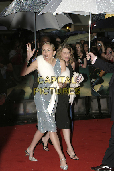 "SHARON STONE.""Catwoman"" film premiere arrivals .Vue Cinema, Leicester Square.London 03 August 2004.full length, fur wrap, shawl, ribbon, blue mettalic dress, silver shoes, funny face, screaming, gesture.www.capitalpictures.com.sales@capitalpictures.com.© Capital Pictures."