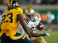 October 6th, 2012: UCLA's Johnathan Franklin tries avoid California's Josh Hill during a game at Memorial Stadium, Berkeley, Ca    California defeated UCLA 43 - 17
