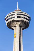 An outside elevator ascends to the observation deck of Skylon Tower in Niagara Falls, Ontario, Canada.