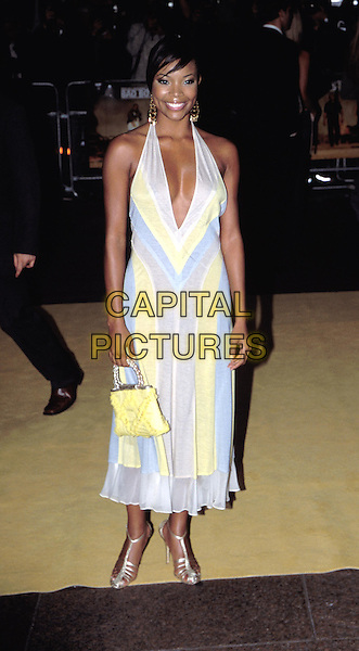 GABRIELLE UNION.Bad Boys II premiere.full length, full-length, blue & yellow halterneck floaty dress, yellow handbag, silver strappy shoes.www.capitalpictures.com.sales@capitalpictures.com.© Capital Pictures.