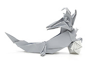 New York, NY, USA - October 27, 2011: An Origami dragon designed by Kunihiko Kasahara and folded from one square of paper without cuts by Esme Cribb. The polyhedral  ball is folded from more than one piece of silver foil.
