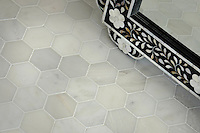 7cm Hex natural stone mosaic shown in polished Calacatta Radiance.