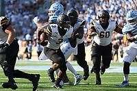 CHAPEL HILL, NC - SEPTEMBER 21: Darrynton Evans #3 of Appalachian State University runs the ball during a game between Appalachian State University and University of North Carolina at Kenan Memorial Stadium on September 21, 2019 in Chapel Hill, North Carolina.