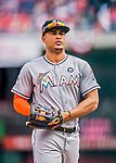 3 April 2017: Miami Marlins outfielder Giancarlo Stanton returns from the outfield during play against the Washington Nationals on Opening Day at Nationals Park in Washington, DC. The Nationals defeated the Marlins 4-2 to open the 2017 MLB Season. Mandatory Credit: Ed Wolfstein Photo *** RAW (NEF) Image File Available ***