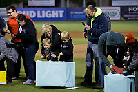 The Efird family is about to win a $2,500 trip to Hawaii following the South Atlantic League game between the Asheville Tourists and the Kannapolis Intimidators at Kannapolis Intimidators Stadium on May 6, 2017 in Kannapolis, North Carolina.  The Intimidators walked-off the Tourists 7-6.  (Brian Westerholt/Four Seam Images)