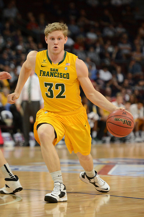 March 10, 2014; Las Vegas, NV, USA; San Francisco Dons guard/forward Tim Derksen (32) dribbles against the Brigham Young Cougars during the first half of the WCC Basketball Championships at Orleans Arena.