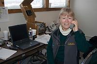 Logistics Coordinator Hannelore Keliher on Phone McGrath Chkpt 2005 Iditarod