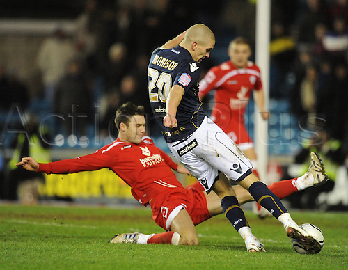 29.01.2011 Championship Football from the New Den. Millwall v Barnsley. Millwall won 2-0. Steve Morison sees a shot blocked by the Barnsley defence