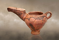 "Vasiliki Ware ""teapot"" with elongated spot and characteristic mottled decorations,  Vasiliki 2300-1900 BC BC, Heraklion Archaeological  Museum."