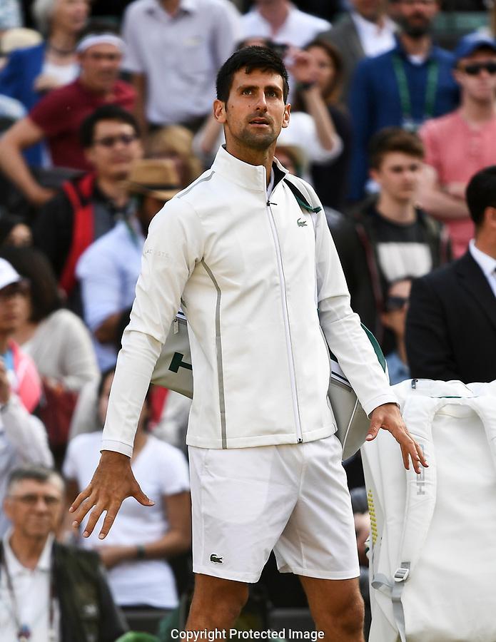 Novak Djokovic (SRB) following his retirement