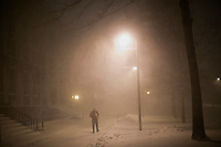 A person walks through Harvard Yard in Cambridge, Massachusetts, USA, as Winter Storm Nemo approaches on Friday, Feb. 8, 2013.