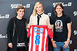 South African actress Charlize Theron with Atletico de Madrid's player Antoine Griezmann (L) and Filipe Luis (R) during the presentation of the film &quot;Fast &amp; Furious 8&quot; at Hotel Villa Magna in Madrid, April 06, 2017. Spain.<br /> (ALTERPHOTOS/BorjaB.Hojas)