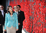 Prime Minister of Thailand Yingluck Shinawatra looks at a wall of poppies during a tour of the Australian War Memorial, Canberra, on Monday May 28th 2012. AFP PHOTO / Mark GRAHAM