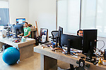 Daniel Negari bought a former Yahoo office to house his business .XYZ. Negari shares his personal office complete with custom concrete desks with company COO Mike Ambrose (left). The office has a community kitchen, whiteboard walls, and lots of unique art throughout, seen in Santa Monica, California July 29, 2015. <br /> (Photo by Kendrick Brinson)