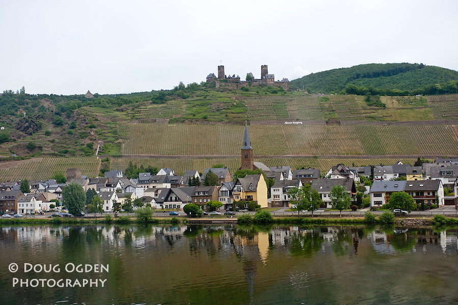 Town of Alken, Germany on the maks of the Moselle River.  The Castle Burg Thurant on the hill.