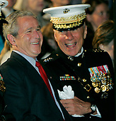 United States President George W. Bush shares a laugh with Michael W. Hagee, commandant of the Marine Corps and chairman of the Joint Chiefs of Staff at a parade May 5, 2006, at the Marine Barracks on Capitol Hill in Washington, DC. Hagee wants to increase funding for 5,000 more Marines, bringing the overall troop size for the Corps to 180,000. <br /> Credit: Joshua Roberts / Pool via CNP