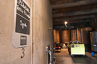 Domaine Borie la Vitarèle. Syrah, Terres Blanches Causses et Veyran St Chinian. Languedoc. Concrete fermentation and storage vats. Sign on tank. Wine press. France. Europe.